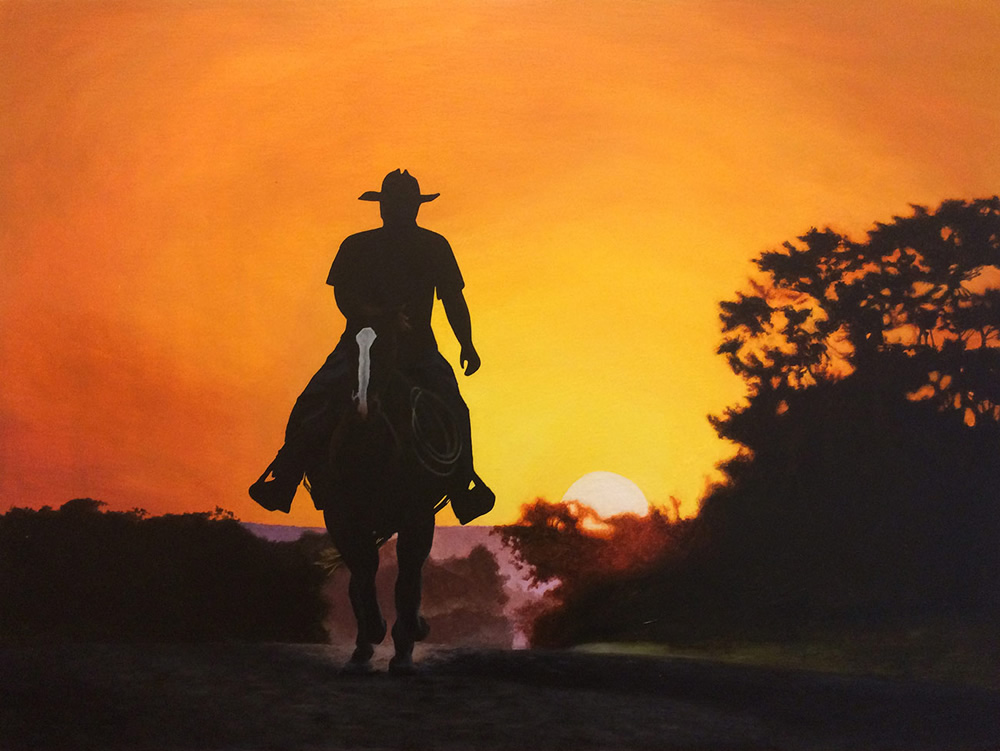 Acrylic painting of a man on a horse with a sunset behind